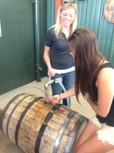 Taste a drop of 120 proof distilled bourbon being filled into a new charred oak barrel.